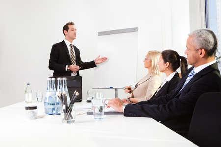 Businessman giving a presentation Stock Photo - 8628318
