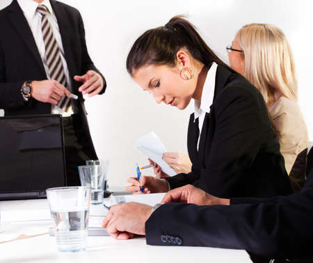 Businesswomen taking notes at the presentation photo