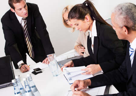 noting: Businesswomen taking notes at the presentation Stock Photo