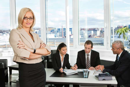 Businesswoman standing in front photo