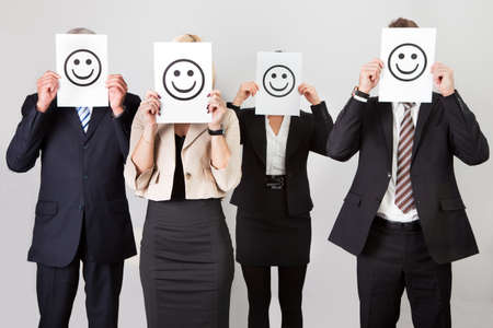 covering the face: Group of unidentifiable business people Stock Photo