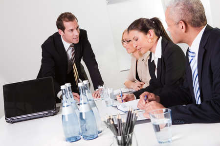 Businessman giving instructiong to his team