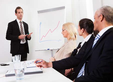 present presentation: Businessman giving a presentation Stock Photo