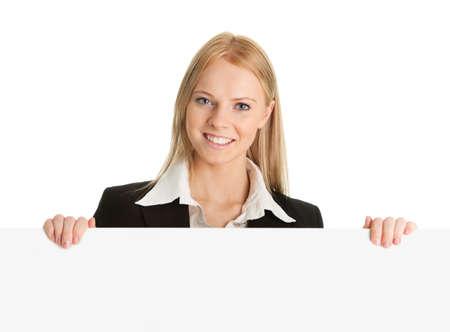 leeg bord: Vrolijke zakenvrouwen presenteren leeg bord Stockfoto