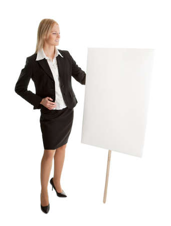 Cheerful businesswomen presenting empty board photo