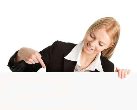pointing up: Cheerful businesswomen presenting empty board