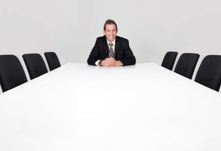Businessman sitting alone photo