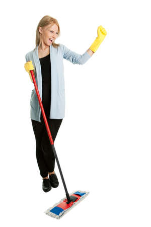 Cheerful woman having fun while cleaning photo