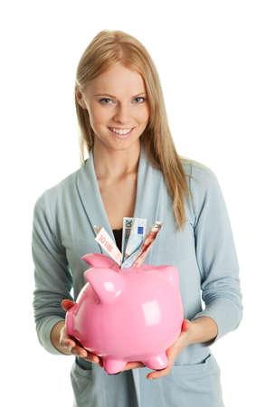 Beautiful young woman saving money Stock Photo - 8863364