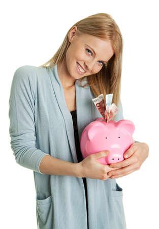 Beautiful young woman saving money Stock Photo - 8863368