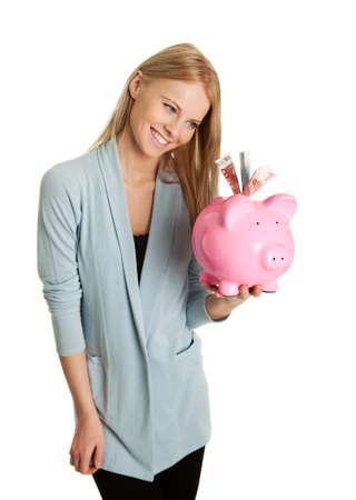Beautiful young woman saving money Stock Photo - 8863341