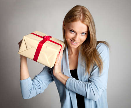 Happy woman holding gift box Stock Photo - 8863367