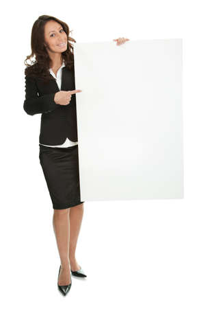 Cheerful businesswomen presenting empty board photo