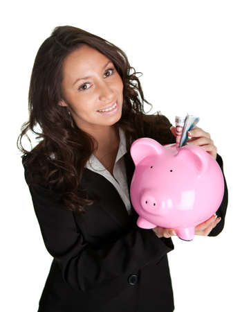 Beautiful young woman saving money photo