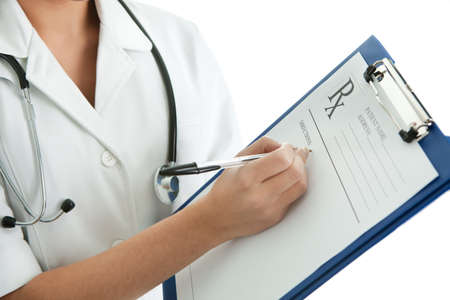 filling out: Cheerful medical doctor woman filling out prescription Stock Photo