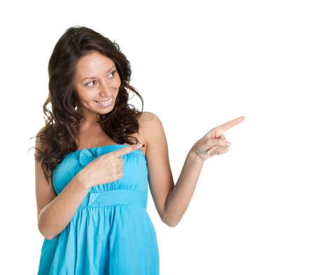look right: Elegant young woman pointing to the right Stock Photo
