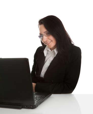 Beautiful business woman working on laptop photo