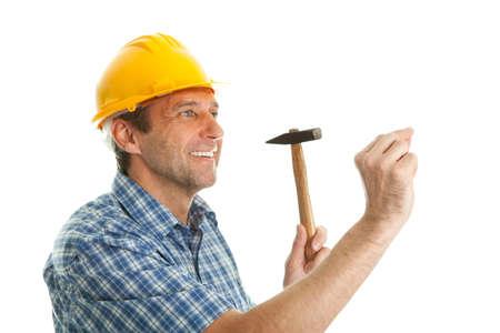 hammering: Confident worker hammering in