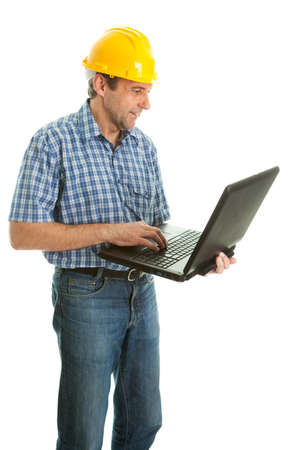 Worker wearing hard hat and using leptop photo