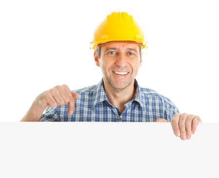Confident worker presenting empty board