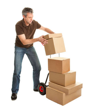 Delivery man staking packages on hand truck Stock Photo - 9104734