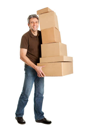 packaging move: Delivery man carrying stack of boxes Stock Photo
