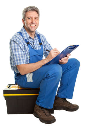Confident service man taking notes photo
