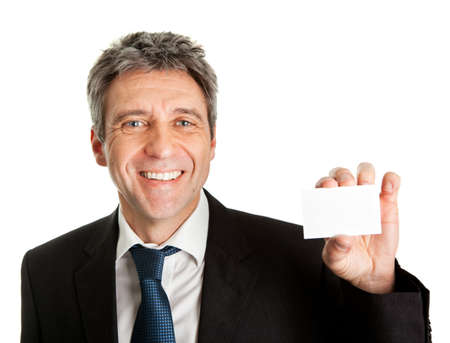 Businessman holding blank card photo