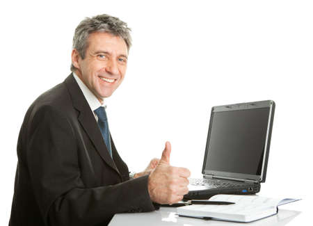 Senior business man working on laptop photo