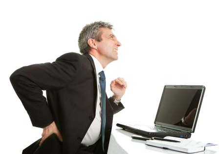 man in pain: Senior business men having back pain Stock Photo