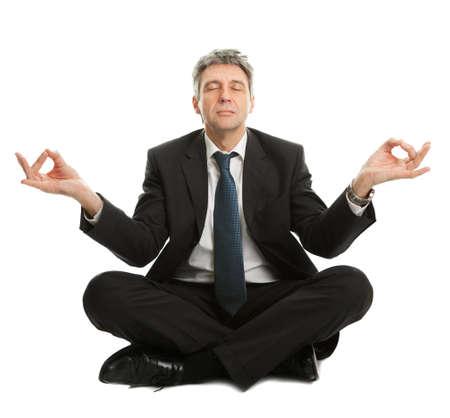 Businessman sitting in yoga position photo