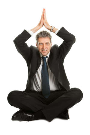 Businessman sitting in yoga position photo