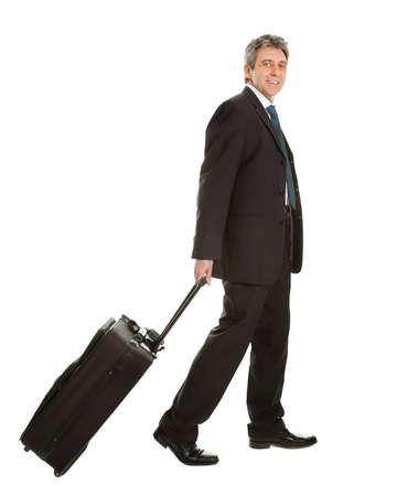 travelers: Senior businessmen with travel bag