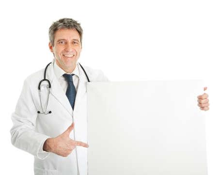 Smiling medical doctor presenting empty board Stockfoto