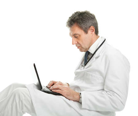 Medical doctor working on laptop photo