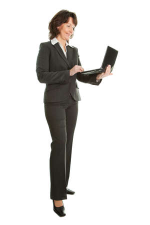 businesswoman legs: Senior business woman using laptop