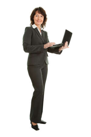 floor standing: Senior business woman using laptop