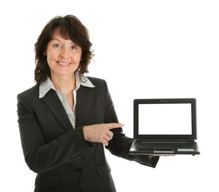 Business woman presenting laptopn Stock Photo - 9104742