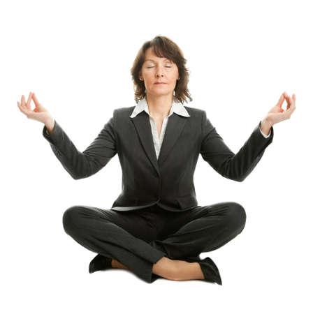 Businesswoman sitting in lotus position photo