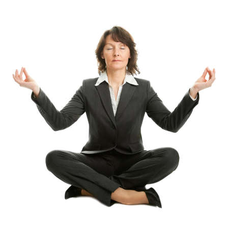 Businesswoman sitting in lotus position photo