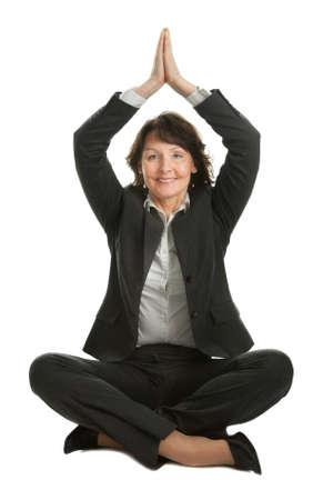 Businesswoman sitting in lotus position Stock Photo - 9104741