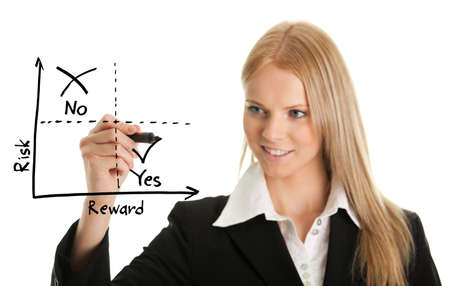 rewards: Businesswoman drawing a risk-reward diagram