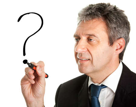 asking: Businessman drawing a question mark Stock Photo