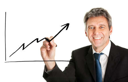 Businessman writing a financial graph Stock Photo - 10200890