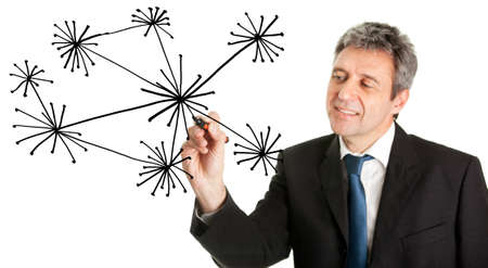 Businessman drawing a social network graph photo