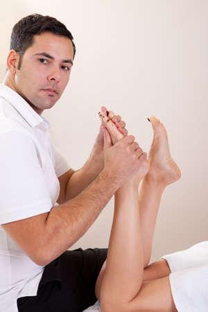 hand rubbing: Therapist doing foot massage