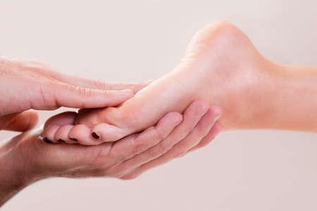 hand rubbing: Foot massage close-up