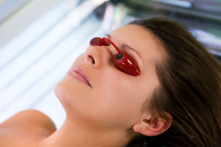 eye protection: Close-up of young women in solarium