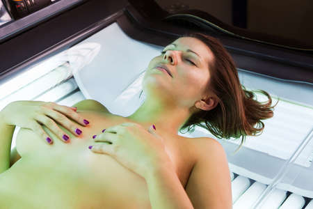 sunbathing: Young woman in solarium