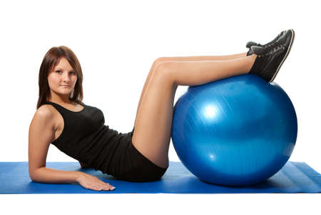 Young women doing crunches on fitness ball photo